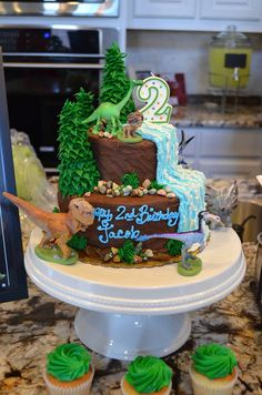 The Good Dinosaur birthday cake- making it through the wilderness