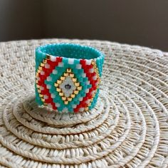 Made to order Evil Eye seed bead ring with wide band, Talisman boho beaded ring, Gifts for girlfriend, Made in Greece Beaded Rings, Beaded Jewelry, Jewelry Rings, Peyote Patterns, Beading Patterns, Handmade Gifts For Girlfriend, Metallic Gold Color, Diy Schmuck, Diy Jewelry