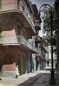 How early 20th century America played and worked, in color c. 1929 New Orleans, Louisiana - A view of galleries in the French Quarter.