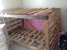 """Bunk bed of pallets! 100% repurposed wood & pallets. Head & foot end are each pallets of identical measurements & I didn't have to """"remodel"""" them at all! My girls love it!"""