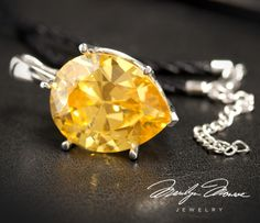 "Replica of the Moon of Baroda, a 24.04ct yellow diamond once owned by Indian and Austrian royalty. It was purchased by Meyer Rosenbaum in 1940 and lent to Marilyn to wear to the premiere of ""Gentlemen Prefer Blondes"" in 1956. In August 2012, the Moon of Baroda was appraised at $1,900,000!"