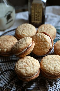 These maple snickerdoodle sandwich cookies with bourbon maple filling are the ultimate cozy fall treat! Make these without the bourbon to make these family friendly.