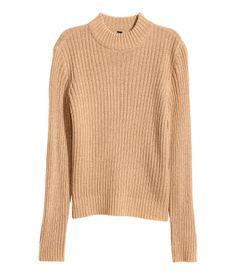 Beige. Long-sleeved mock turtleneck sweater in a soft rib knit. Slightly wider cut.