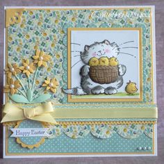 lovely handcrafted Easter card ... sweet spring print papers in blues and yellow ... luv the Penny Black image of cat with a basket of chicks ...