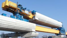 Mechanized Construction of Prestressed-Concrete Bridges