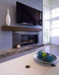 Reclaimed wood mantle - need to switch out our traditional honey oak one with something like this.