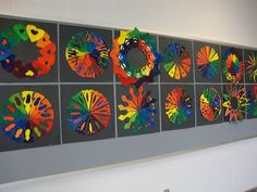 Creative Color Wheel...Materials: - tempera paint (red, yellow, blue) - paintbrushes - white drawing paper - pencils - scissors - glue or glue sticks - black mounting paper I like to do a color theory lesson at least once a year with each grade. I think these just turned out absolutely beautiful!