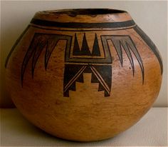 A Hopi red polychrome globular jar by Nampeyo and/or Annie Healing Nampeyo with feather tip, terrace and hatched rectangle designs, circa 1900-1910.