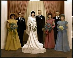 Each bridesmaid wore a matching floor-length dress, crown, and gloves in her own color at this 1947 wedding.