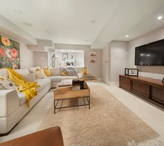 The space is awash in warm neutrals, with invigorating touches of sunny yellow to energize the decor. Ruby Photography Studio