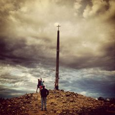 About 70km after Leon, you'll reach the highest point of the entire Camino. Standing tall and isolated at this spot is a large cross. The tradition is for people to leave an item of sentimental value at the cross.