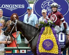 Caption: Untapable with Rosie Napravnik wins the Breeders' Cup Distaff (gr. I) Breeders' Cup at Santa Anita  on Oct. 31, 2014, in Arcadia, California. R9distaff  image Photo by Anne M. Eberhardt