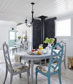 In an effort to make every inch count, Amanda swapped out a table for six (which would've better accommodated occasional guests) with a four-seater that suits only the family's daily needs. A single chair accented in bright blue adds a pop of color and visually connects it to the adjoining blue-and-white living room...