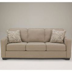 The warm vintage casual design of the Aleyna Beige Sofa by Ashley is inviting for your friends & family. Available online or in store.