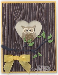 Core'dinations Card Stock with the Woodgrain embossing folder, Owl punch, & Hearts framelits. Thanks Nancy!