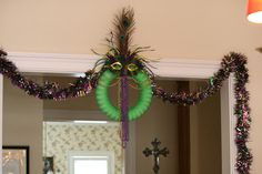 Mardi Gras Wreath in a Doorway with Garland; Peacock feather accents