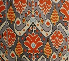 Orange ikat fabric grey aqua yellow