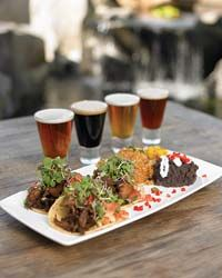 Stone Brewery's Duck Tacos.  Their cookbook gives the recipe.  You can cheat and use pre-made duck confit.  Delicious!!