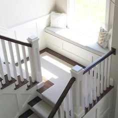Staircase window seat. Neutral Staircase window seat with linen cushion…