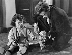 Jimmy playing with a young girl on the set of Rebel Without a Cause.