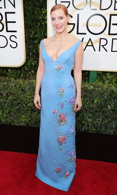 JESSICA CHASTAIN   picks a periwinkle Prada dress with abstracted floral beading along the side and Piaget high jewelry.