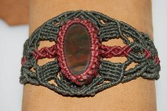 This special and unique creation is handmade with the Macramé technique using first quality waxed threads in Dark Green and Bright Red tones. At the center, the bloody red drops in deep earthy green of these highly selected, oval Heliotrope Cabochons. Closing with sliding system and