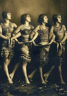 During the 1920s there was a big Egyptian Revival, following the discovery of Pharoah Tut's tomb. impacting fashion, graphics, design and more ~ showgirl dress outfit