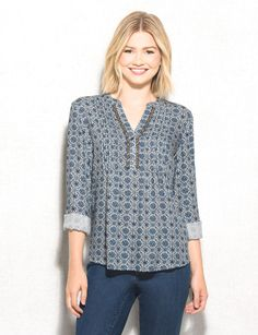 A chic popover to wear any day of the week, pair with jeans, add a few bangles and your favorite booties for a look we know you'll love! Imported.