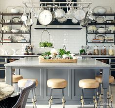 Chef's kitchen with everything at your fingertips. Love the subway tile wall and gray wood island.