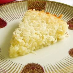 Self-Crust Coconut Pie - A moist coconut pie that makes its own crust when it bakes. Maybe drizzle some chocolate on top :)