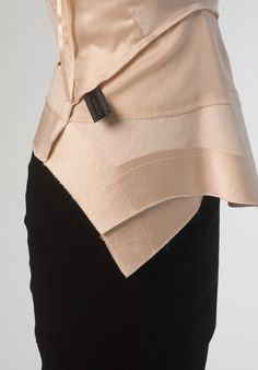 Vogue Patterns V1451 by Donna Karan. The top shown inside-out so you can see all the different fabrics this top uses. Raw-edge finish and techno fabrics.