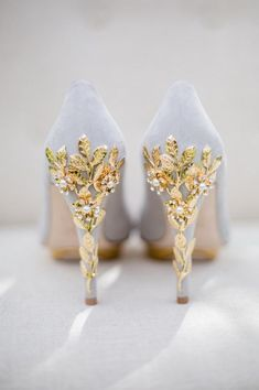 Want to stick with the white dress but are ready to be adventurous with your accessories? These gorgeous gray wedding shoes with heels adorned with gold leaves and pearls are the perfect go-to. They are soft and demure with a little bit of attitude as you are walking away (the perfect bridal combination).