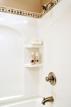 decorating and update ideas for a fibreglass shower or tub surround above the wall using tile and hotel style curtain rod
