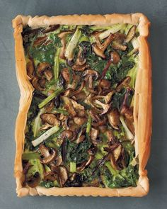 Mushroom, Spinach, and Scallion Tart - Martha Stewart Recipes Vibrant spinach leaves intermingle with roasted mushrooms in a light-as-air (and easy-to-assemble) phyllo shell. The custardlike filling comes together quickly in a blender. Tart Recipes, Cooking Recipes, Detox Recipes, Yummy Recipes, Healthy Recipes, Potluck Side Dishes, Main Dishes, Brunch, Mushrooms