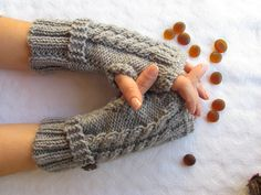 Grey Fingerless Gloves With Wooden Buttons,Knitting Pattern, Hand Arm Warmers,Winter Accessories, Fall Fashion,Mittens. $24.00, via Etsy.
