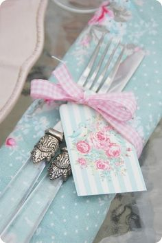 I think it's just lovely to attach a pretty card to the cutlery for special occasions, such as birthdays. You could write something nice to the person sitting there, or just write people's names.