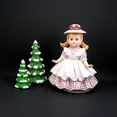 Cute little music box with a sweet-faced little girl dressed in pigtails, a hat, checked dress and white lacy pinafore. Reminds me of Heidi or the little vintage Ginnie dolls. Would make a treasured gift for a young girl. Made of bisque ceramic, she plays Its a Small World and turns in a circle while music is playing. (Wound on the bottom by turning the circular disc.) Condition is excellent with no cracks or repairs. Music box works; not over wound and still usable. She stands 7 tall and…