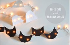 Dress up Christmas lights with black cats and friendly ghosts