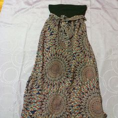 Long tribal printed dress Long dress with an interesting print on it, slits up both sides for easy walking abilities. Xhilaration Dresses Strapless