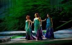 "Sprites from Rusalka (on opera by Dvorak). The story is similar to ""The Little Mermaid"" except that Rusalka is a water nymph. It doesn't end in a Disney wedding; instead, the  Prince falls for another woman and Rusalka is doomed to lure men into the depths of her lake for all eternity."