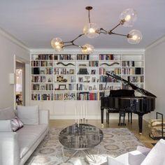 A beautiful library/living room renovation by Platt Dana Architects, Lyndsey Adelman pendant, custom bookshelves