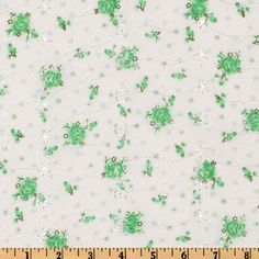 Floral Eyelet Mint from @fabricdotcom  You will fall in love with this light weight embroidered eyelet fabric.  It is perfect for flirty summer dresses, blouses, skirts, bathing suit cover ups and children's apparel.   Flowers are screenprinted on fabric.