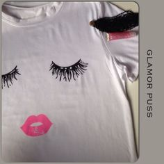 NEW GLAMOR PUSS T SHIRT New in package glamor puss T shirt in a white cotton blend fabric. Round neck short sleeve with small roll cuff & a bit of stretch. This is not a fitted t shirt and gently flares away from the waist offering some options to style the T. The eyelash & pink pouty lipstick graphic makes this a perfect statement piece to shout your style!! Please note this is not the same Glamor Puss T shirt as the size M listed in my closet!! Tops