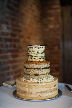 Momofuku Milk Bar wedding cake // photo by Levi Stolove // view more: http://ruffledblog.com/industrial-literature-wedding-in-nyc/