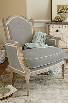 Drawing inspiration from an antique our designers fell in love with on their travels through the tiny mountainous region of Andorra, this bergère chair replicates the original's embracing shape and gorgeous cathedral-style back. | Soft Surroundings