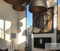 Lighting Is Crucial In Designing The Perfect Space!  In This Cocoa Bean Project, There Was A Large Space We Had To Work With. Adding Large, Round Lighting Of Various Sizes Helped In Making Space Feel Cozy Yet Keeping To The Design Theme.  #CocoaBeanInteriorDesign #cocoabean  #interiordesign #designideas #interiordesignideas #design #bushlodge #lodgedesign #africanvilla #designerhospitality