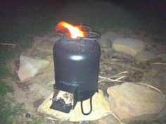 Burning off the newness on the Rocket Stove.