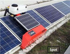 Powered by its solar-charged battery, Spot rolls along concrete tracks that keep its weight off the solar panels it cleans. Spot can be programmed for wet or dry cleaning at selected intervals and activated from a smart phone. It can also clip the ground cover between the concrete racks and manage the project's drip irrigation system.