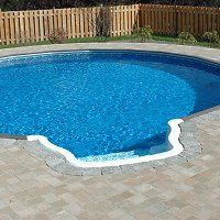 Ultimate Above Ground Swimming Pool installed to look like an in ground pool....interesting .....good for smaller spaces.