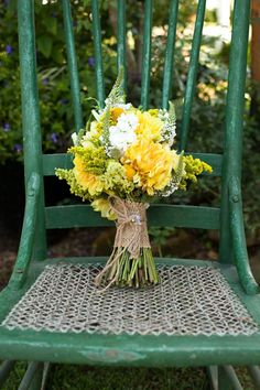 yellow flowers and green chair.